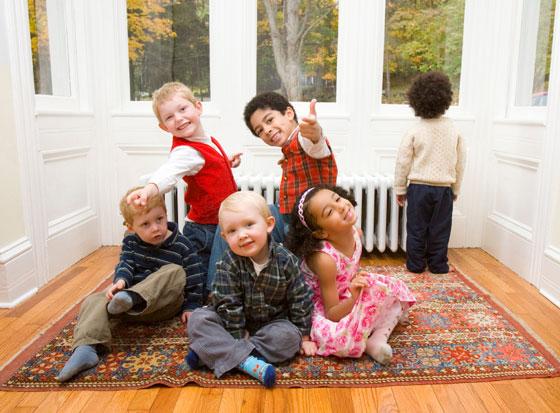 kids-on-rug-08458472-sml